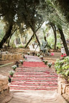 Lay patterned rugs down aisle for cozy boho vibes   Lifestories Wedding