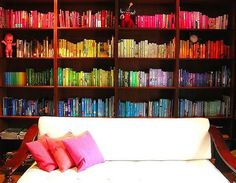 The crazy organizer in me loves this... arrange books by color... book rainbow.