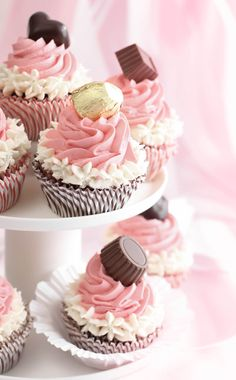 Neapolitan Bonbon Cupcakes - chocolate cake with white and pink butter cream frosting.. topped with a chocolate candy.