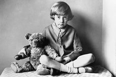 Photo of the real Christopher Robin Milne, son of A.A. Milne, and his famous bear, Pooh.  I had no idea they were real.... so cool.