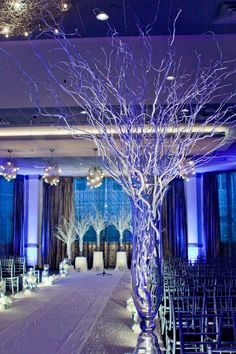 love the idea of branches at a wedding