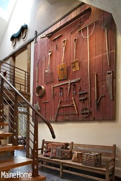 Primitive tools and some other nice antiques - love the barn wood wall, and the long bench