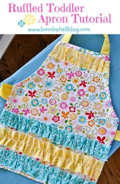 """Make a simple and sweet apron for your toddler with this simple toddler ruffle apron tutorial....why reinvent the wheel?""""  So, instead, I am going to share with you the link to the pdf pattern from Mama Liberated that I used so many years ago, and then I am going to show you in pictures how I modified it to fit a tiny, floofy little diva.  So, here we go! For this apron I used the new line of Summer Breeze Cotton fabric."""