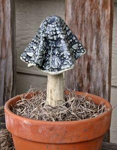 mushroom in pot - garden art
