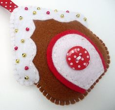 Gingerbread House Felt Ornament - retail from UK shop Devonly Crafts; no pattern, but lots of lovely felt Christmas felt ornaments for sale for inspiration