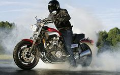 """2005 Yamaha V-Max. I WANT ONE!  I've wanted a v-max since 1992 when my grandpa first told me about """"V-boost."""" But the black with red pinstriping on the 20th anniversary bike is just sexy!"""