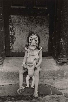 Masked Child with a Doll by Diane Arbus ☆ Vintage Halloween ☆ Black and White Photography.