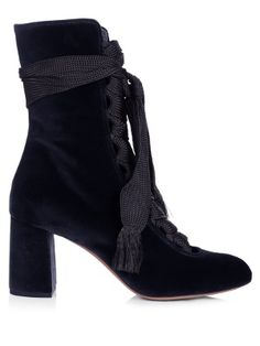 Inspired by the Ballet Russes, Chloé's Harper ankle boots chime with this season's decadent theme. They're crafted from rich blue velvet, and feature a round toe, stacked block heel, and bohemian lace-up ribbons that wrap romantically around the ankle. Try yours with a tie-neck blouse and flounce-hem midi skirt for an on-brand look.