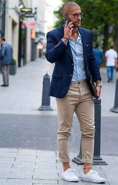 Try pairing a blue sportcoat with beige chinos for a work-approved look. White low top sneakers will contrast beautifully against the rest of the look.   Shop this look on Lookastic: https://lookastic.com/men/looks/blazer-dress-shirt-chinos/18416   — Blue Blazer  — Light Blue Dress Shirt  — Silver Watch  — Beige Chinos  — White Low Top Sneakers  — Black Bracelet