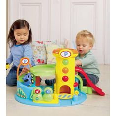$74.99 - * * EBEANSTALK TOP SELLER * *This chunky Whizz Around Garage offers lots of pretend driving fun and is ideal for little hands to grip. It includes an exciting spiral descent and ramps, 3 cars and 6 sounds. This fun toy will help your child develop their manual dexterity and provide hours of imaginative play. Requires 3 x AA batteries (not included). DIMENSION: 22 x 16 x 18 inchesVehicle Play Sets!