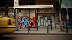 """Waiting for a bus in Lotus pose"" in Athens, Greece :-) www.yogaoncrete.gr"