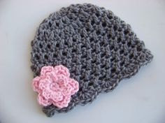 Crochet Baby Hat in gray w/ a pink flower.  I am going to learn how to do this before my next granddaughter is born.
