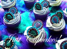 Peacock cupcakes... I also like the purple and teal feathers on the table.
