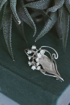 Hey, I found this really awesome Etsy listing at https://www.etsy.com/listing/198828769/lily-of-the-valley-art-nouveau-brooch