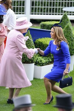 princess Haya curtsies before the Queen