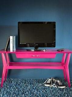 Re-invent tables or stands as showstopping statement pieces with high-gloss, bold-colored paint.