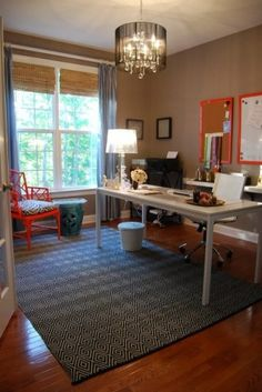 An IKEA dining table makes a spacious substitute for a desk; a floating shelf from the same company boosts the work area.