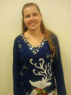 Tabitha is ready for the Holiday Lunch with a full speed ahead Reindeer sweater (jumper)!  Jingle on, you Shameless Holiday shirt wearer!