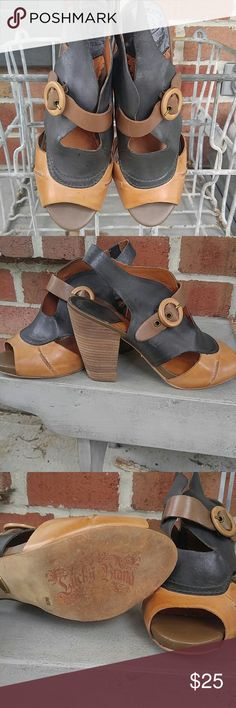 Lucky Brand peep toe slingbacks size 8 Brown and black Lucky Brand peep toe heels with buckle accent.  Soft leather true to size.  Heel is 4 inches size 8 Lucky Brand Shoes Heels