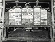 The safety screen on stage at the Grand Theatre, Llandudno, complete with adverts for local firms such as Wagstaff's Pianos and the Pabo Hall Hotel