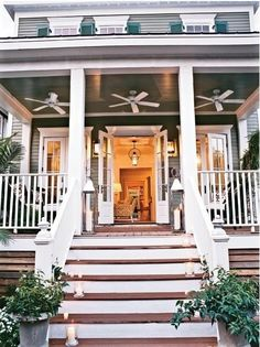 What a great idea to put fans on a porch (or maybe a screened in porch) for those hot summer days!