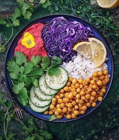 You see me bowlin'.. catch me ridin' healthy!  This delicious bowl has #chickpea and #beet #hummus red cabbage rice  #cucumber  #seasmeseed vinegarette and #cilantro.   Find more #recipes like this by following @310recipes!    :: @wholefoods