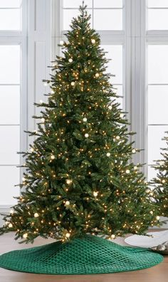 The Telluride Tree replicates firs found on the snowy peaks of its namesake skiing village. Hundreds of warm white LEDs are interspersed with larger, round bulbs. This lighting variation creates unexpected focal points on our lush, lifelike evergreen.