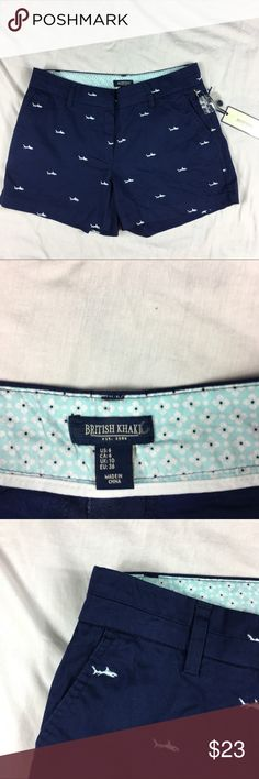British Khaki  blue shark mini short shorts British Khaki navy blue/light blue shark mini short shorts   Women's Size: 6   97% cotton, 3% spandex   Machine washable   Approx measurements: waist – 31 inches; inseam – 4 inches; rise – 8 ½ inches   New with tags – see pictures british khaki Shorts
