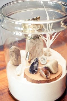 so cool, jewelry displayed in jar with sand in it