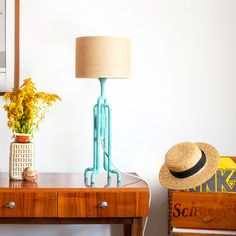Turquoise table lamp with yellow jute shade in mid-century modern apartment. Industrial spirit in new, colorful and extraordinary incarnation.