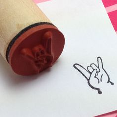 Rock on Hand Sign Rubber Stamp - Heavy Metal Devil Horns - Sign of the Devil. $3.75, via Etsy.