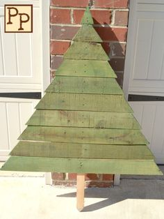 Green Pallet Tree by PeppersPickins on Etsy, $30.00 - this would be a great DIY project for outdoor decor
