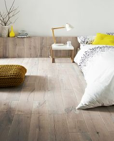 Scandinavian Style | Wood flooring is a staple in Scandinavian interiors...Lengthy, wide planks in light or bleached wood are de rigueur.