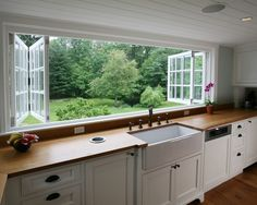 Would love this!! High Street Market Wall of sliding windows in kitchen and beautiful wood counter tops--is that a hole for trash? Very cool!