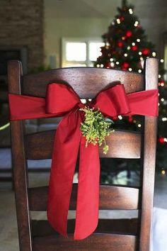 Tie some beautiful red satin wired ribbon around the back of your table chairs, then use these artificial floral picks to stick in the center of the bow. Brilliant AND beautiful! Reuse the supplies every year:)