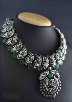 Featuring antique pendant and secured with an adjustable back dhori, this oxidised german silver necklace set steals the subject of conversation. Silver Jewellery Indian, Silver Jewelry, Silver Rings, Silver Pendants, Silver Bracelets, Antique Jewellery Designs, Fashion Jewellery Online, Silver Anklets, Oxidised Jewellery