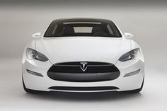 Ohh La La I do want one of these!  Tesla Model S Electric Sedan has Greater Driving Range than Expected (320 Miles) : TreeHugger