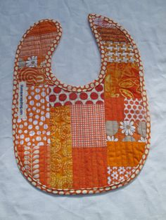 Cute patchwork bib in orange and white by bluesquarequilting Yellow Birthday, Baby Presents, Unisex Baby, Baby Patterns, Baby Bibs, One Color, Fabric Crafts, Fabric Design, Baby Shower Gifts