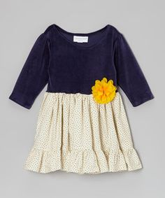 A classic cut and lively mix of prints make this dress sweet for every darling girl to wear. Add in the fun of a sweet flower accent and lightweight cotton for a frock that's brimming with playtime style.