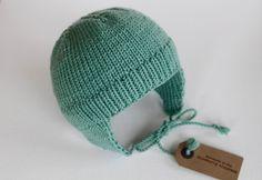 Sea green seafoam merino wool baby girl boy bonnet handknit. £27.99, via Etsy.
