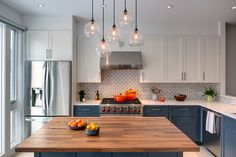 Style ideas for any transitional l-shaped eat-in kitchen. I love the lights over the island and the butcher block counter. Don't like the fridge placement.