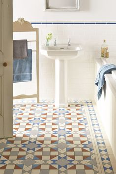Eltham pattern with a new shade - bright Pugin Blue - makes a statement with all white bathroom sanitaryware. This pattern will make a statement in hallways, living rooms, bathrooms, kitchens - wherever it is used! New colours, patterns and shapes means our geometric Victorian style floor tiles look great in traditional and contemporary homes. Available from TileStyle.