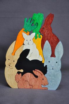Pile of Bunny Rabbits Easter Animal Puzzle Wooden Toy- The puzzle measures 5 1/2 inches across and 7 1/2 inches tall. It is 3/4 of an inch thick.