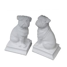 These curious ceramic pugs are happy to help support books on the library shelf or hold down papers on your writing desk. Product: