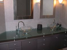 Duo raised countertops with glass sinks, his and her bathroom design | Calgary's House of Mirrors