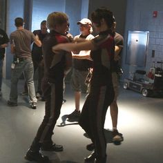 aaw! Josh and Jennifer hug behind the scenes of the hunger games. GIF