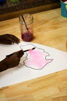 Creating a watercolor mural of the world in kindergarten-- Reggio Inspired