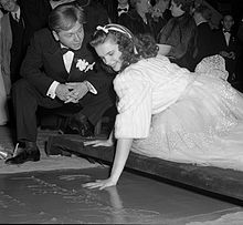 Rooney watches Garland put her handprint into cement at Grauman's Chinese Theatre, 1939.