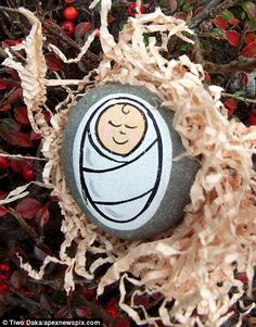 Jesus on a Pebble - The mystery giver: Secret artist scatters hundreds of pebbles hand-painted with baby Jesus