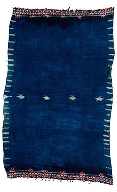 Africa | Indigo woollen shawl ~ bakhnouf ~ from Tunisia | Wool and cotton; with tie-dyed border of interlined spheres and white woven details along the edges and to the centre